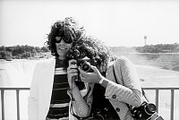 Christopher Simon Sykes (b.1948). Mick Jagger and photographer Annie Leibovitz pose at Niagara Falls during the Rolling Stones tour of the Americas, 1975. Leibovitz (b.1949) focuses her Nikon F camera on Sykes. Credit: Photo by Christopher Simon Sykes/Hulton Archive/Getty